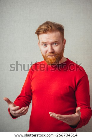 man holding up his hands showing he has nothing - stock photo