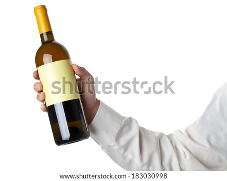 Man holding white wine bottle isolated on white background - stock photo