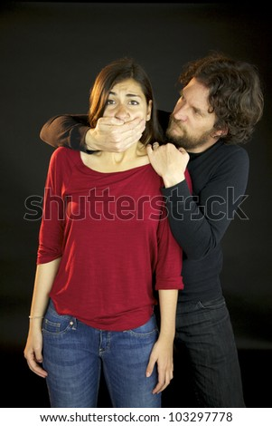 Man holding woman's mouth violence abuse