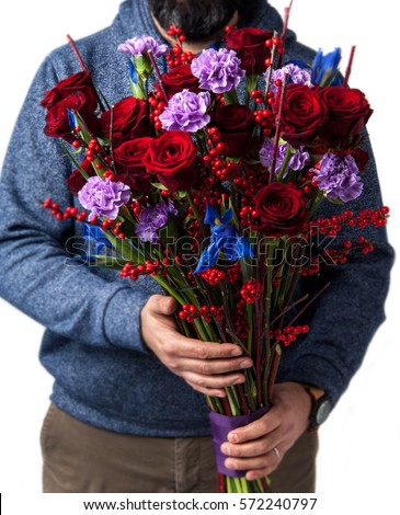 man holds bouquet of red roses. Valentine's Day