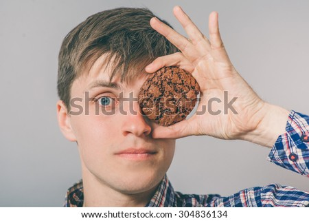 man holds cookies