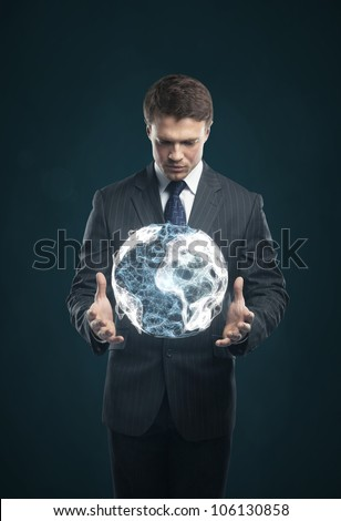 man holds in  hands an abstract Earth - stock photo