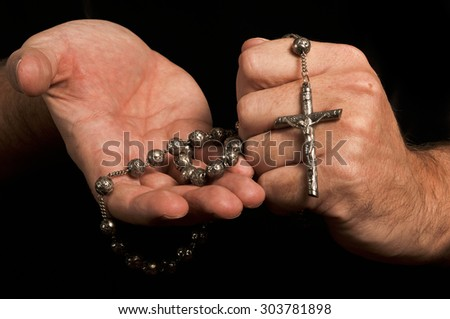 Man holds rosary
