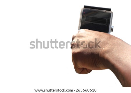 Man holds small extreme digital camera in hand, isolated on white background