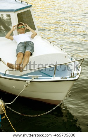 man holiday on the yacht lying at sunset in summer