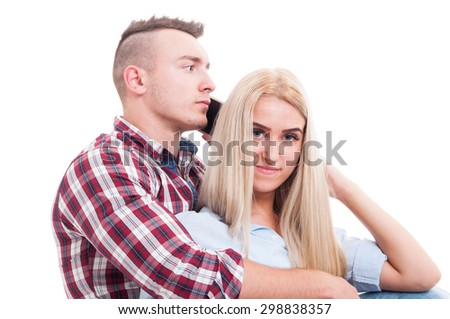 Man hugging woman and talking on the phone with another female or girl. Cheating boyfriend concept
