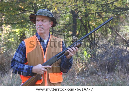 Man hunting in a field - stock photo