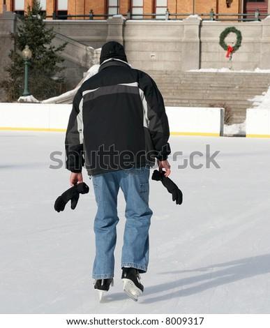 man ice skating - stock photo