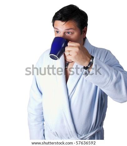 Man in a bathrobe drinking coffee - stock photo