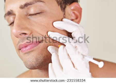 Man in a beauty clinic getting wrinkle treatment near his mouth - stock photo