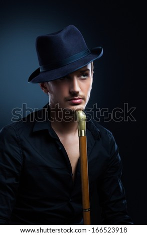 man in a black hat - stock photo
