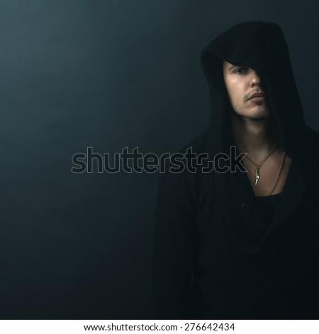 man in a black hoodie upset - stock photo