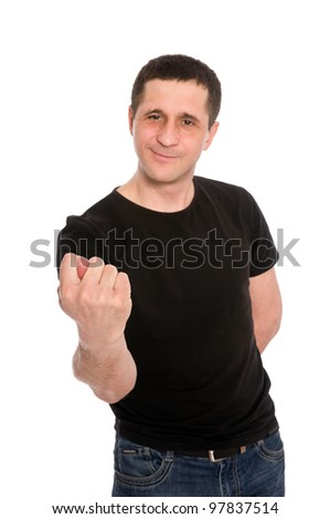 man in a black T-shirt showing a fig isolated on white background - stock photo
