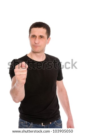 man in a black T-shirt showing a fig isolated on white background (focus on hand) - stock photo