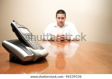 Man in a business shirt waits for a call