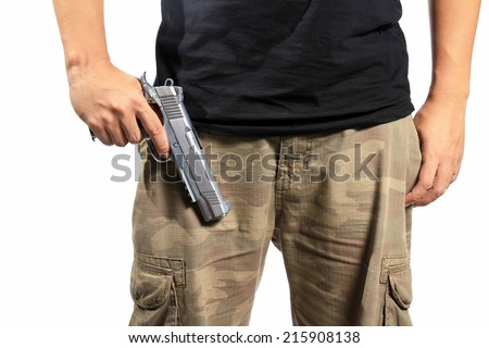 Man in a camouflage pants holding a gun isolated on white background, Army, Semi-automatic handgun, 45 pistol. - stock photo