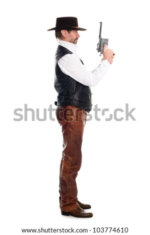 Man in a cowboy hat with a gun - stock photo
