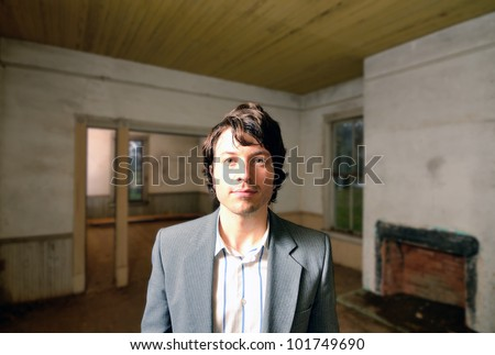 Man in a dilapidated old house