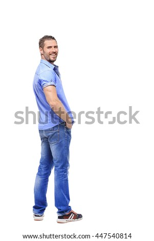 man in a full-length white background turns from a shoulder - stock photo