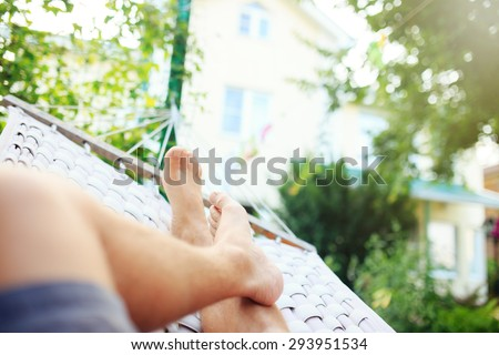 Man in a hammock on a summer day, close up photo - stock photo