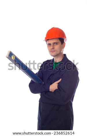 man in a helmet and  blue robe holding building level - stock photo