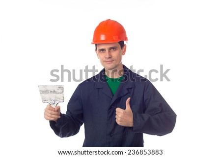 man in a helmet and  blue robe holding building trowel, show thumb