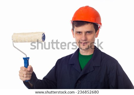 man in a helmet and  blue robe holding roller for painting - stock photo