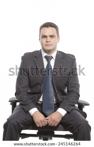 Man in a jacket sitting on a chair - stock photo