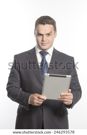 Man in a jacket stand with the tablet