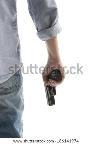 Man in a jeans holding a gun isolated on white - stock photo