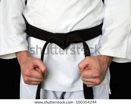 Man in a kimono and belt for martial arts - stock photo