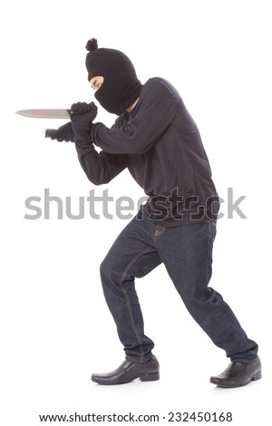 Man in a mask holding flashlight with a knife on a white background