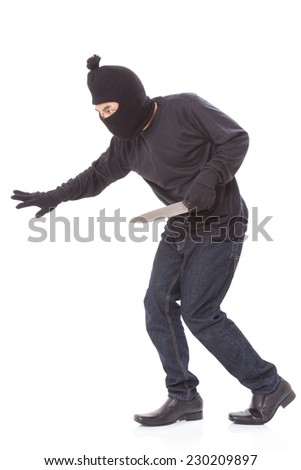 Man in a mask with a knife on a white background