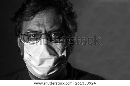 Man in a medical mask. Black and white - stock photo