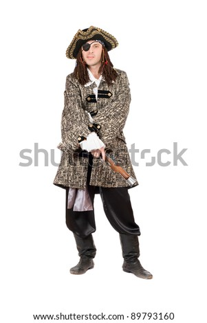 Man in a pirate costume with pistol - stock photo
