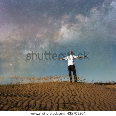 man in a prairie at the night