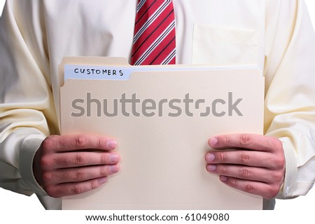 Man in a shirt and a tie holding a manila customer folder. - stock photo