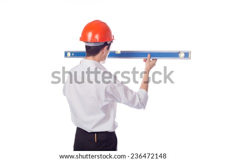 man in a shirt in orange construction helmet look at builder level; isolate background; isolate background; turn your back