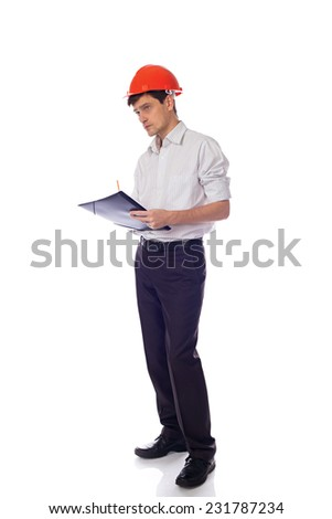 Man in a shirt in orange construction helmet writes in black folder; isolate background - stock photo
