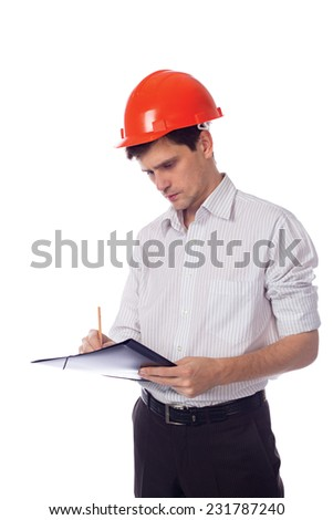 Man in a shirt in orange construction helmet writes in black folder; isolate background