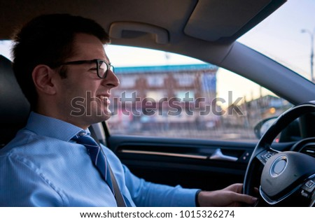 man in a shirt while driving