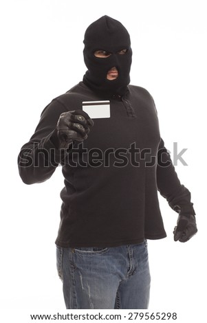 Man in a ski mask with a stolen credit card to steal your identity on a white background. - stock photo