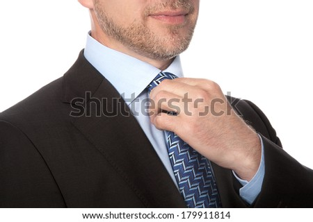 Man in a suit and tie on a white background - stock photo