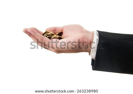 man in a suit holding coins in the hand - stock photo