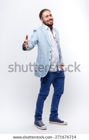 man in a suit on a white background, greeting, handshake, extends his hand in greeting, welcome - stock photo