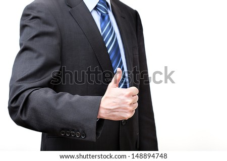 Man in a suit showing OK gesture, isolated - stock photo