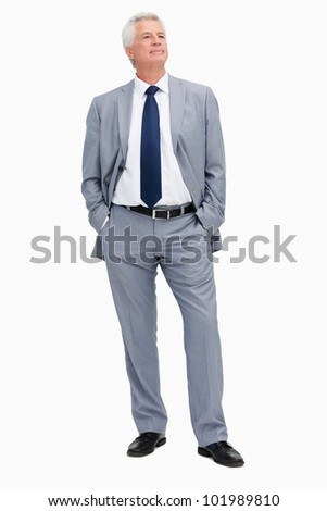 Man in a suit with hands in the pockets against white background