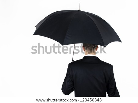 man in a suit with umbrella with his back forward