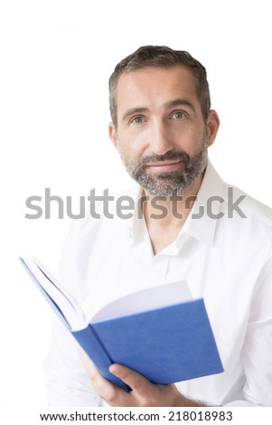 man in a white shirt reading a book