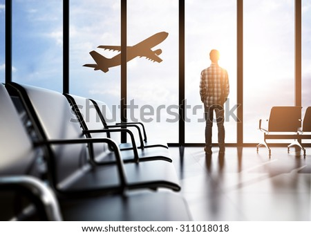 Man in airport - stock photo